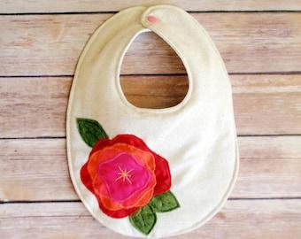 Senorita Baby girl linen bib with red and pink flower