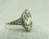 Circa 1915 Edwardian Platinum Marquis Shaped Ring with 1.45 carat Old European Cut diamond
