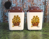 Plastic salt and pepper shakers with black eyed susans