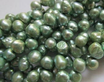Top Drilled mostly Flat sided Rice Freshwater Pearls in a Misty Green 7 inches (18cm)