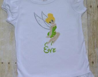 Fairy appliqué ruffle shirt.