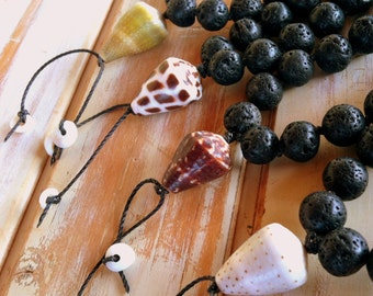 Hand knotted black lava hand mala juzu prayer beads with cone shell and puka