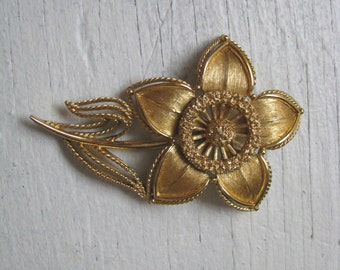 Monet gold tone vintage flower pin brooch with embossed details