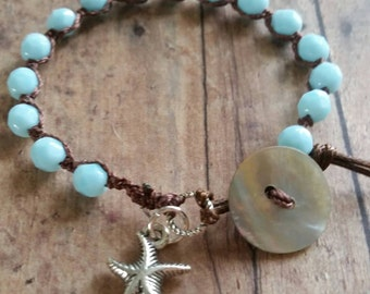 Beachy, boho bracelet. Sky blue beads. Silver starfish and mother of pearl. Wear alone or stack it in true, boho style.