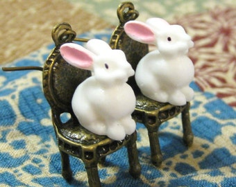 Alice in Wonderland white rabbit on a dining chair earrings