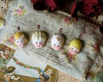4pcs of Antique dolls head resin pendant