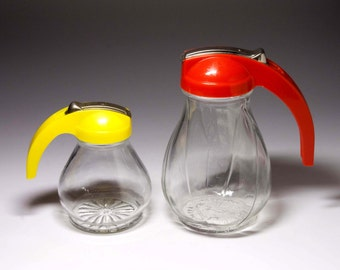 Vintage Red and Yellow Syrup Pitchers, Set of two - circa 1940's