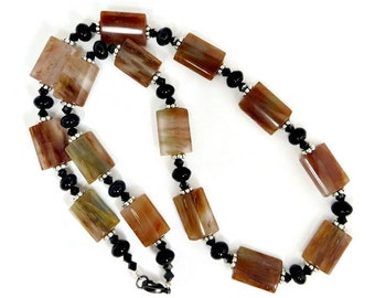 Brown Crystal, Black Onyx, Black Swarovski Crystals, and Silver Heishi Spacers Necklace