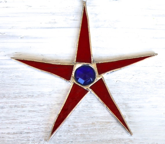 American Jewel- 7 inch stained glass star with faceted blue glass center