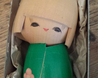 wooden carved doll