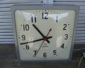 vintage American industrial wall mount electric analog clock cast aluminum housing