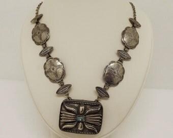 Vintage Estee Lauder Solid Perfume Compact Pendant Necklace~Southwestern Tribal Concho 1973 Silvertone perfume Locket Pendant Necklace