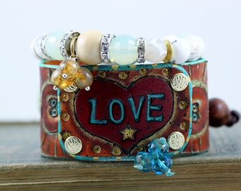 more LOVE,Leather cuff bracelet, hand carved and painted, boho, hippie jewelry, cowgirl jewelry