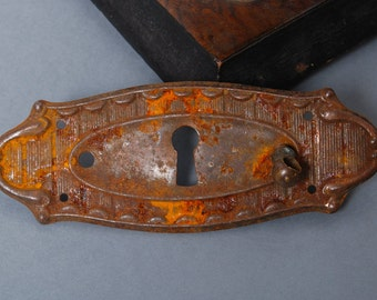 Antique metal key hole escutcheon plate, rustic patina. Art Nouveau