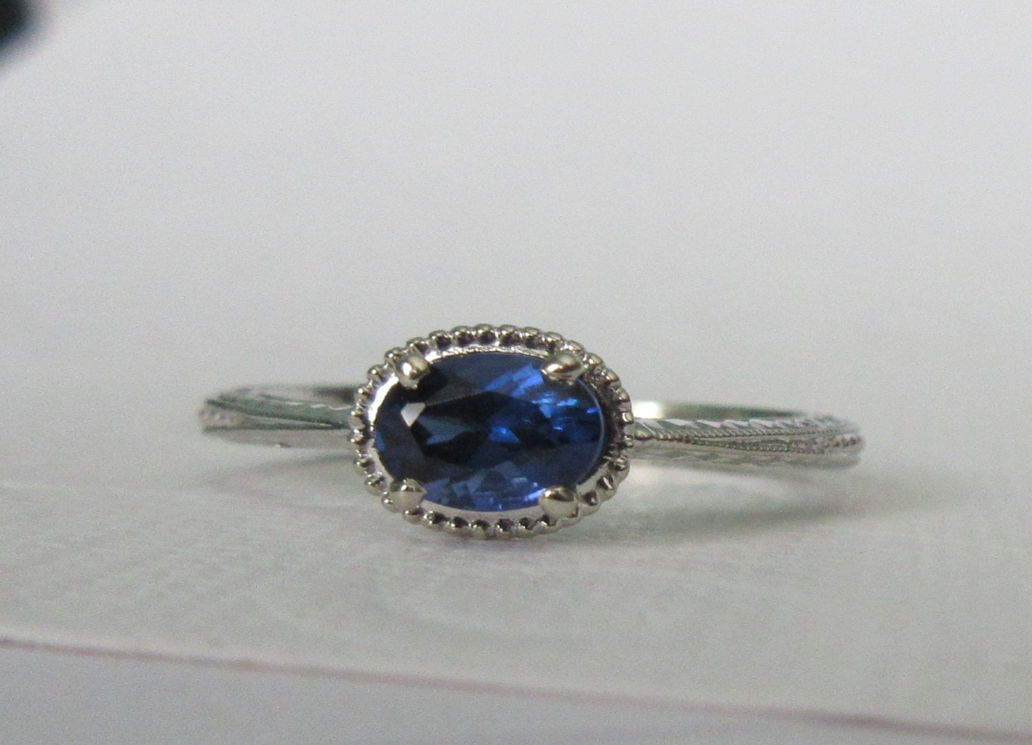 white gold and oval sapphire ring vintage inspired east west