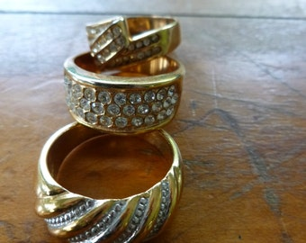 vintage rings,lot of 3 bands w clear stones,goldtone