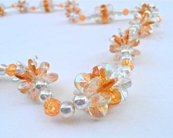 Vintage Orange Peach Flower Clusters Bead Necklace Single Strand Aurora Borealis Light Amber Plastic Iridescent Lei Floral Costume Jewelry
