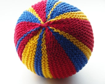 Baby toddler toy ball with bell. Montessori. Striped red, blue and yellow. Primary colors.