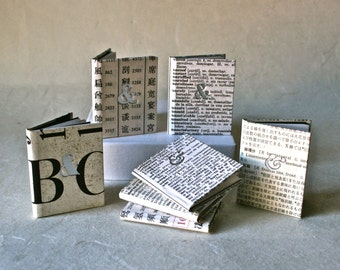 Trio of Small Journals with Covers of Recycled Text in Assorted Languages and Silver Letterpressed Ampersands