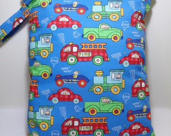 """Large wet bag. 13"""" X 16"""".Cars,Trucks,Bus and Train print fabric.Heat sealed seams. Ready to Ship"""