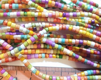 16 inches of 3mm Tube Rondelle Multi-color Dyed Magnesite Beads.