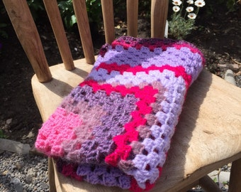 Beautiful crocheted baby blanket in pinks and purples