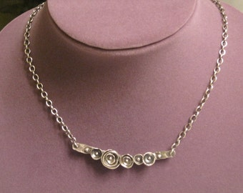 Fine silver row of roses necklace