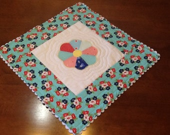 Pretty Quilted Table Topper with rick rick trim and available matching napkins