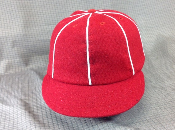 Red wool flannel 8 panel cap with short 1910 visor, white soutache and button. Custom made in any size.