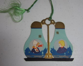 1920's P.F. Volland unused art deco die cut and gold gilded bridge tally in the shape of salt and pepper shakers with dutch girl and boy