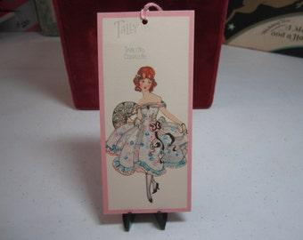 1920's unused art deco Chas. S Clark bridge tally card pretty lady wearing an elaborate off the shoulders dress holds fancy fan
