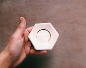 white hexagon ring dish with golden ring