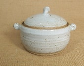 Stoneware individual Casserole pot, with speckled white glaze.