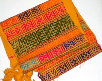 Vintage weaving in orange with reds, blues, greens, purples and pink
