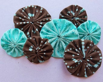 fabric yoyos of chocolate brown/aqua dotted fabric and aqua blue abstract design fabric--two sizes--mixed lot of 7