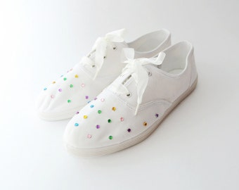 Vintage white canvas sneakers with colorful studs