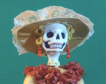 Isadora, Catrina from Arley Berryhill pattern made from recycled fabrics 18 inches tall in orange and yellow