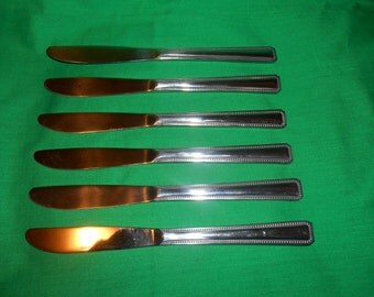 "Six (6) 8 1/4"" Stainless Solid Dinner Knives, from Rogers Co./ Stanley Roberts, in the Enjoy Pattern."