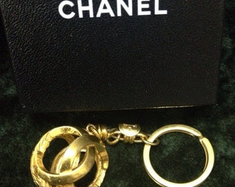 Vintage CHANEL gold tone round Sphere CC key chain with CC marks. Great vintage gift.