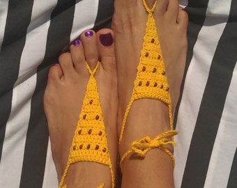 Yellow crochet barefoot sandals with purple beads