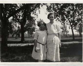 Old Photo 2 Girls Sisters wearing Dresses Plaid Dress Hair Bow 1920s Photograph snapshot vintage