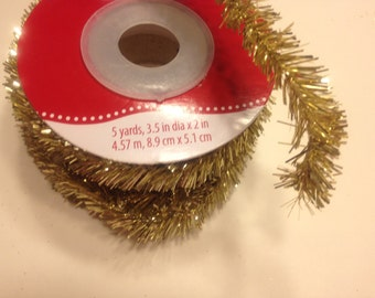 5 yards of gold color tinsel garland, (SS)