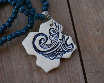 Blue Wave ceramic pendant necklace with blue wooden beads
