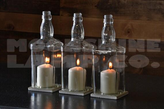 Whiskey bottle glass hurricane candle centerpiece for Glass bottle centerpieces weddings