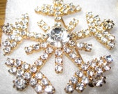 EISENBERG ICE  Rare, Vintage Snow Flake with Brilliant Clear Rhinestones on a Gold Tone Backing - signed and Mint Codition