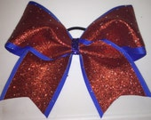 """Cheer Bows for sale; 3"""", 3 inch cheer bow with red hographic glitter and scattered rhinestones on royal blue ribbon"""