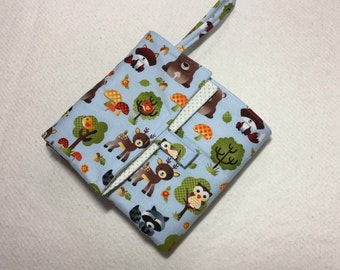flip and go travel diaper changing pad/baby changing pad/travel diaper clutch with pockets - woodland animals on light blue