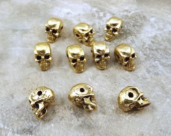 10 Gold Tone Pewter 5.5mm Skull Beads with a Horizontal Hole - 5064