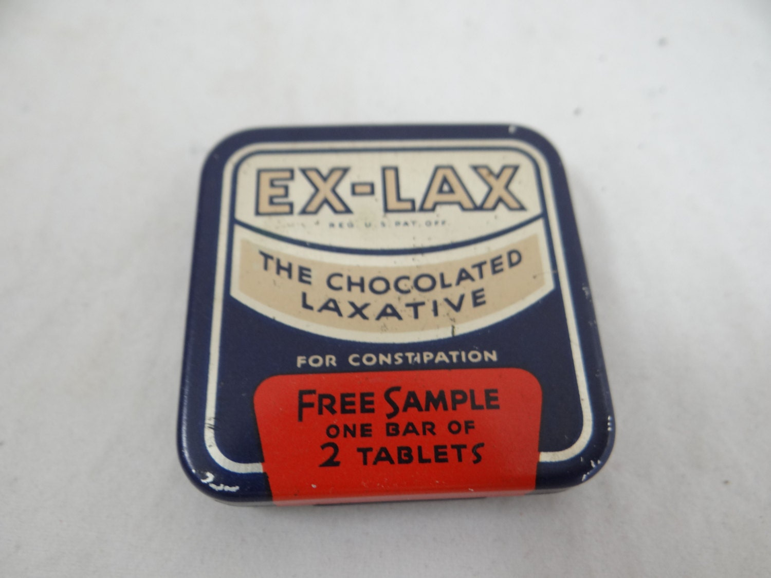 A Graphic Light Box And A Mid Century Dresser Turning The: 1940s Vintage Ex-Lax Free Sample Tin With Insert The