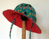 Reversible baby/ toddler sun hat with ties in Hedgehoglets with red pin dot reverse, size 6 to 12 months ready made